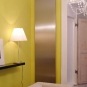 Outline Get Up electric radiator in brushed stainless steel