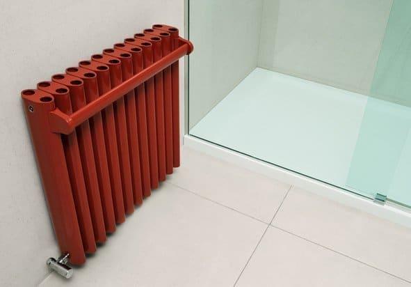 Orange Ron in a bathroom with a towel rail