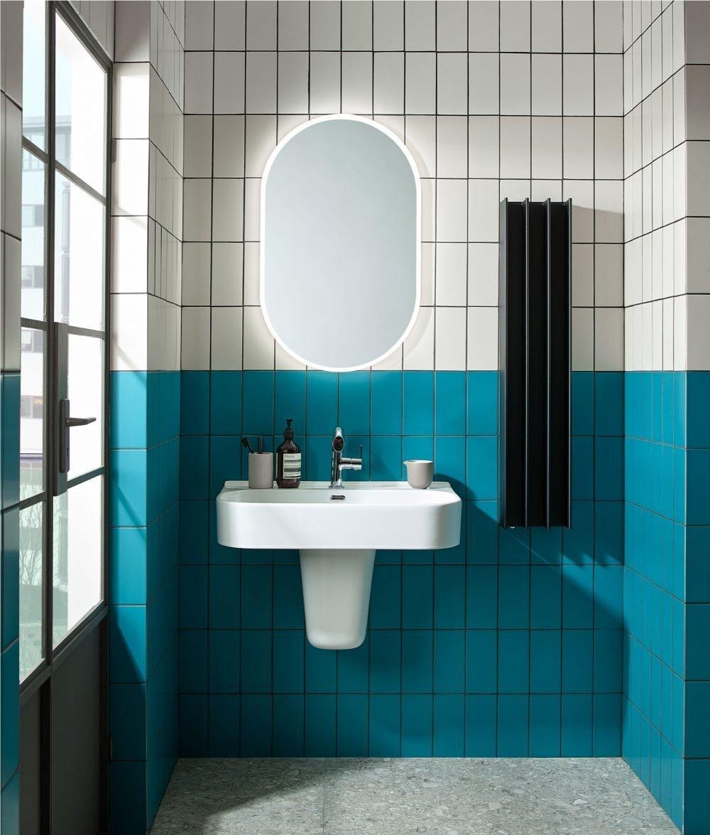 Heated towel rail in designer bathroom