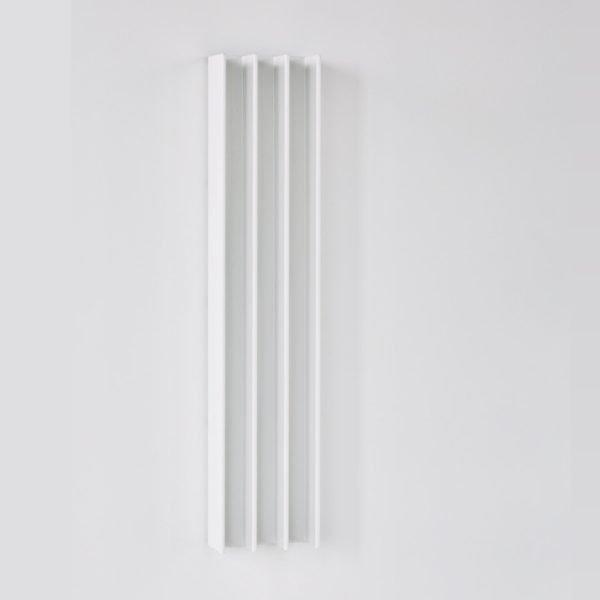 White Gordon heated towel warmer on white wall