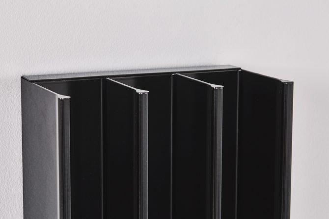 Eskimo Heat's black gordon designer towel rails in a contemporary bathroom