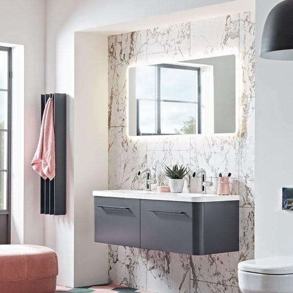 Black Gordon Heated Towel Warmer in bathroom with pink towel