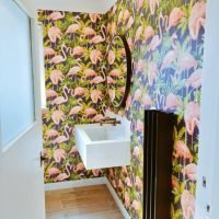 Black Gordon Heated Towel Rail in a bathroom with flamingo wall paper